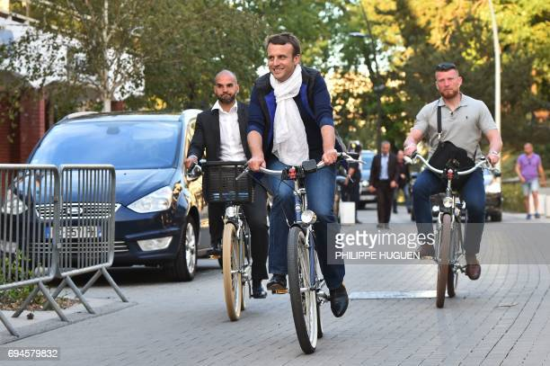 TOPSHOT French President Emmanuel Macron takes a bicycle ride on June 10 in Le Touquet northern France the city where Macron votes on the eve of...
