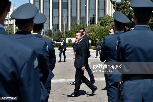 French President Emmanuel Macron takes part in a wreath laying ceremony at the monument of the unknown soldier in Athens on September 7 during his...