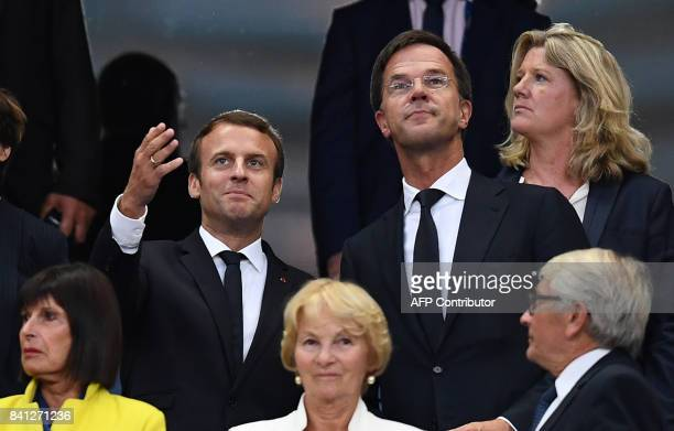 French president Emmanuel Macron talks to Dutch Prime minister Mark Rutte prior to the 2018 FIFA World Cup qualifying football match France vs...