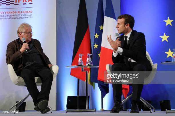 French President Emmanuel Macron talks to European MP Daniel CohnBendit during an open debate on Europe on October 10 2017 at the Goethe University...