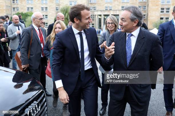 French President Emmanuel Macron talks to Professor at the Paris Institute of Political Studies Gilles Kepel as Culture Minister Francoise Nyssen...