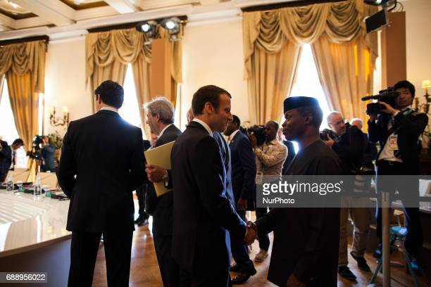 French President Emmanuel Macron talks to the nigerian representative at the G7 Summit expanded session in Taormina Sicily on May 27 2017