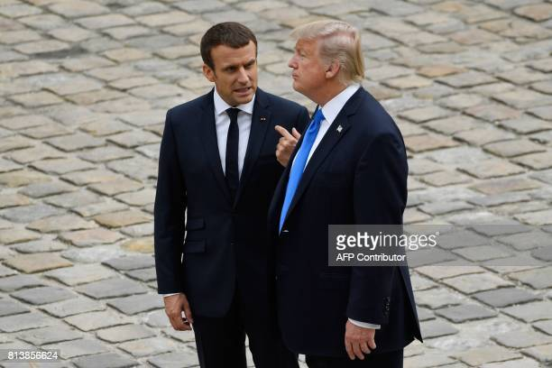 French President Emmanuel Macron talks to US President Donald Trump during a welcome ceremony at Les Invalides in Paris on July 13 2017 Donald Trump...