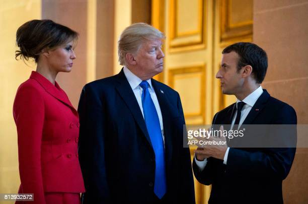 French President Emmanuel Macron talks to US President Donald Trump and US First Lady Melania Trump as they visit Napoleon Bonaparte's tomb at Les...