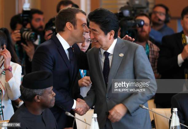 French President Emmanuel Macron talks with Japanese Prime Minister Shinzo Abe during the Summit of the Heads of State and of Government of the G7...