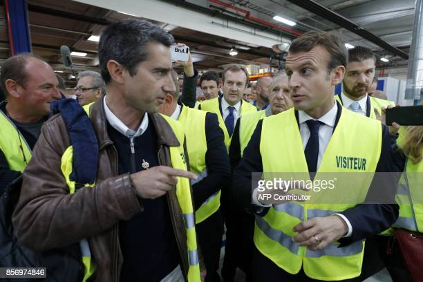 French President Emmanuel Macron talks with La France Insoumise leftist party's MP Francois Ruffin during a visit to the Whirlpool factory in Amiens...