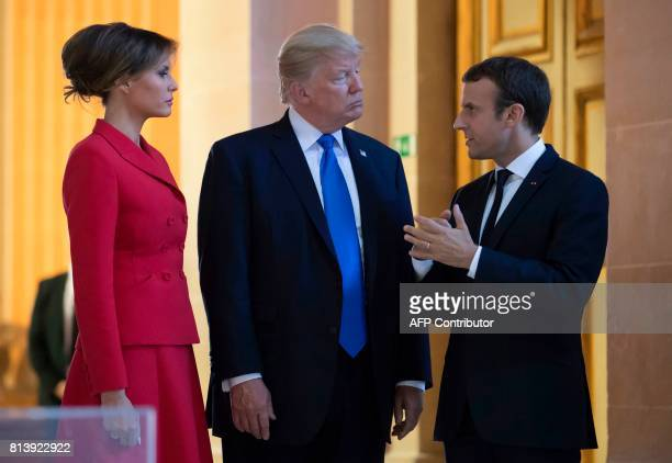 French President Emmanuel Macron talks with US President Donald Trump and First Lady Melania Trump as they visit Marechal Foch's tomb at Les...