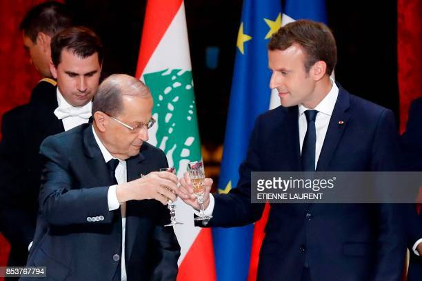 French President Emmanuel Macron toasts with Lebanon's President General Michel Aoun during a state dinner at the Elysee Presidential Palace in Paris...