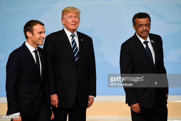 French President Emmanuel Macron US President Donald Trump and DirectorGeneral of the World Health Organization Tedros Adhanom leave after posing for...