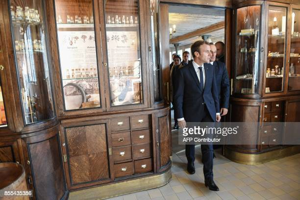 French President Emmanuel Macron visits the Raeapteek one of the oldest running pharmacy in Europe on the sidelines of a European Union summit on...