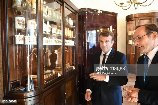 French President Emmanuel Macron visits the Raeapteek one of the oldest running pharmacies in Europe in the centre of Tallinn Estonia on the...