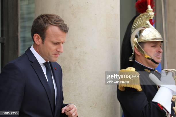 French president Emmanuel Macron waits for the arrival of his Central African Republic's counterpart for their meeting at the Elysee palace on...