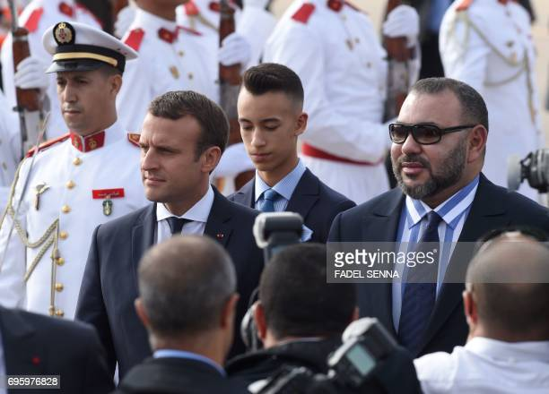French President Emmanuel Macron walks alongside Moroccan King Mohammed VI upon his arrival in Rabat on June 14 2017 Macron is on an official visit...