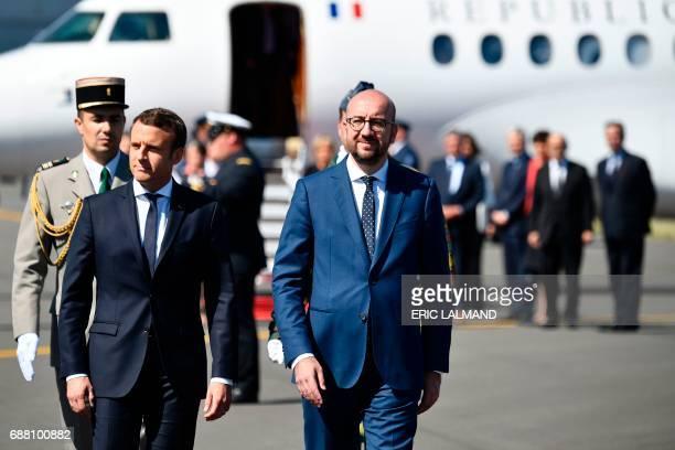French President Emmanuel Macron walks with Belgian Prime Minister Charles Michel upon arrival at the military airport in Melsbroek Steenokkerzeel...