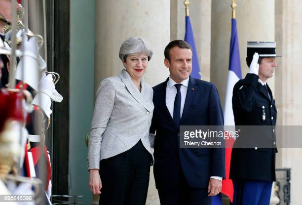 French President Emmanuel Macron welcomes British Prime Minister Theresa May prior to a working dinner at the Elysee Presidential Palace on June 13...