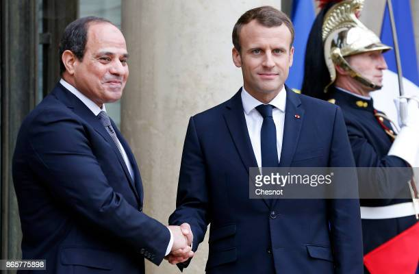 French President Emmanuel Macron welcomes Egyptian President Abdel Fattah alSisi prior to a meeting at the Elysee Presidential Palace on October 24...