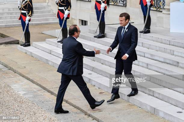 French President Emmanuel Macron welcomes former French President Francois Hollande for Paris 2024 Olympic City reception at Elysee Palace in Paris...