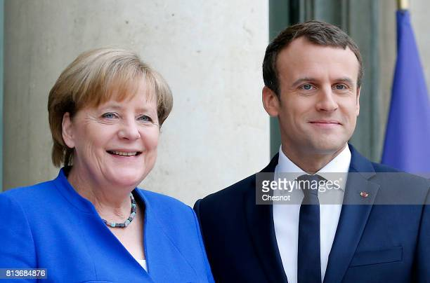 French President Emmanuel Macron welcomes German Chancellor Angela Merkel prior to a meeting at the Elysee Presidential Palace on July 13 2017 in...