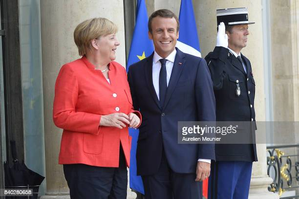 French President Emmanuel Macron welcomes German Chancelor Angela Merkel at Elysee Palace on August 28 2017 in Paris France During the meeting they...