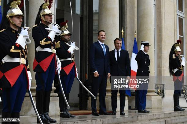 French President Emmanuel Macron welcomes Irish Prime Minister Leo Varadkar upon his arrival at the Elysee Palace in Paris ahead of a meeting on...