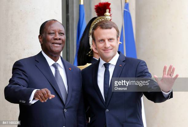 French President Emmanuel Macron welcomes Ivory Coast president Alassane Ouattara prior to a meeting at the Elysee Presidential Palace on August 31...