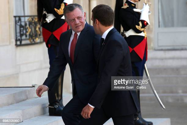 French President Emmanuel Macron welcomes King Abdullah II of Jordan prior to a meeting at the Elysee Presidential Palace on June 19 in Paris France...