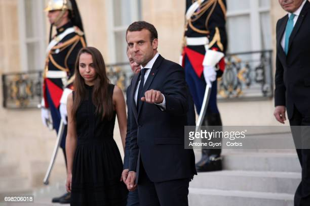 French President Emmanuel Macron welcomes King Abdullah II of Jordan and her Daughter prior to a meeting at the Elysee Presidential Palace on June 19...