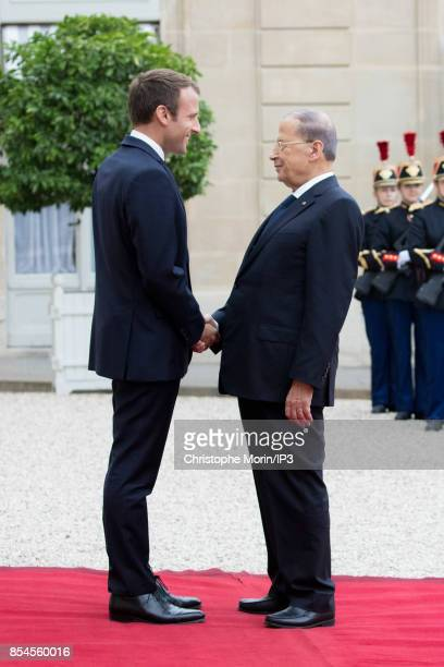 French President Emmanuel Macron welcomes Lebanese President Michel Aoun at the Elysee Palace on September 25 2017 in Paris France Aoun made a three...