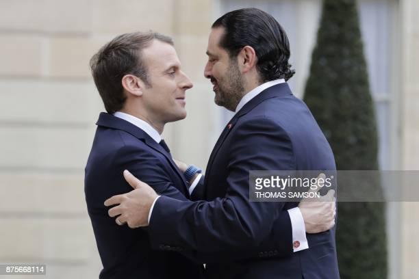 TOPSHOT French President Emmanuel Macron welcomes Lebanese Prime Minister Saad Hariri at the Elysee Presidential Palace on November 18 2017 in Paris...