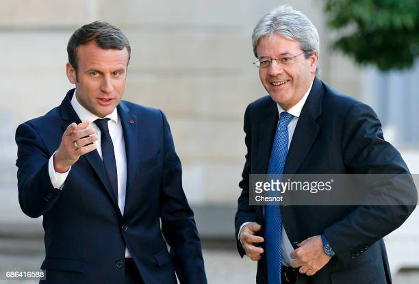 French President Emmanuel Macron welcomes President of the Italian Council Paolo Gentiloni prior to a working dinner at the Elysee Presidential...