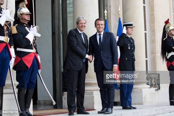 French President Emmanuel Macron welcomes President of the Italian Council Paolo Gentiloni at the Elysee Palace on August 28 2017 in Paris France...