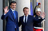 FRA: France President Emmanuel Macron Meets Qatari Emir Sheikh Tamim Bin Hamad Al-Thani At Elysee Palace In Paris