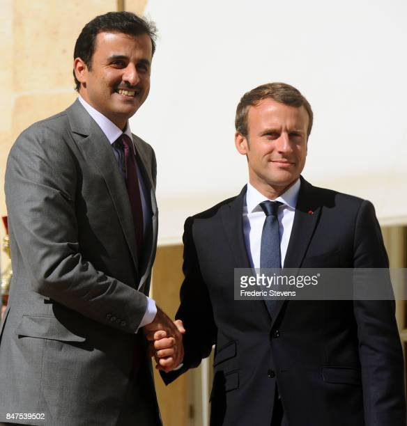 French President Emmanuel Macron welcomes Sheikh Tamim bin Hamad Al Thani Emir of Qatar before a working meeting at Elysee Palace on September 15...
