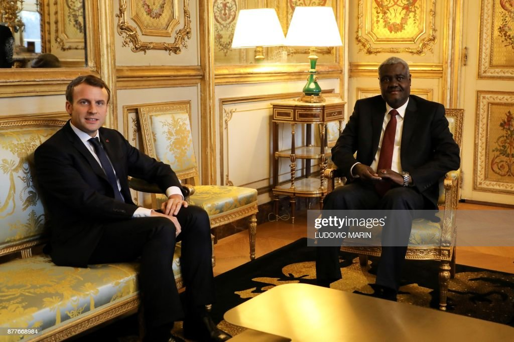French President Emmanuel Macron welcomes the African Union Commission chairman Moussa Faki at the Elysee Palace