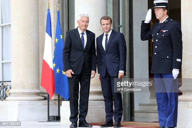 French President Emmanuel Macron welcomes the Secretary General of the Council of Europe Thorbjorn Jagland before a meeting on August 31 at the...