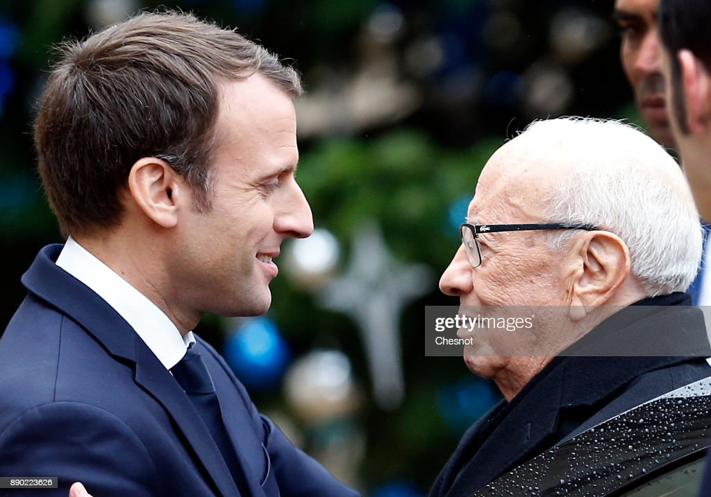 French President Emmanuel Macron welcomes Tunisian President Beji Caid Essebsi prior to their meeting at the Elysee Presidential Palace on December 11, 2017 in Paris, France. Beji Caid Essebsi is on an official visit to Paris.