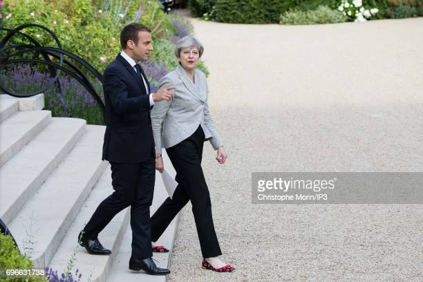 French President Emmanuel Macron welcomes UK Prime Minister Theresa May at the Elysee Palace for a meeting a work dinner and in order to assist to a...