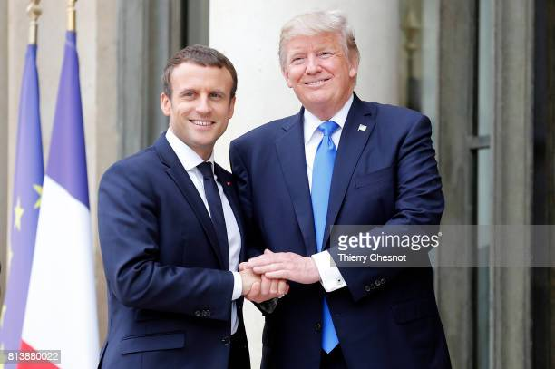 French President Emmanuel Macron welcomes US President Donald Trump prior to a meeting at the Elysee Presidential Palace on July 13 2017 in Paris...