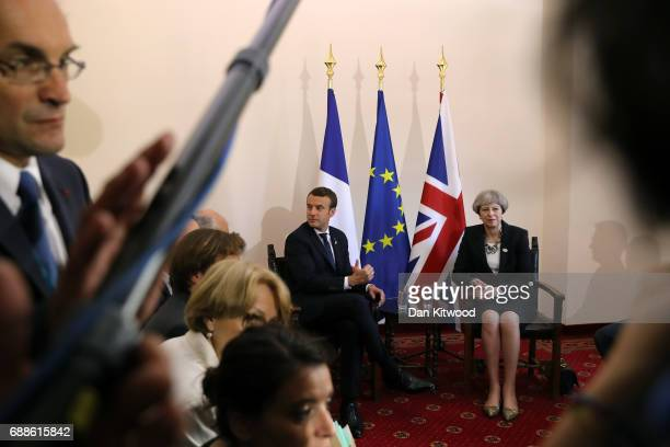 French President Emmanuel Macron with British Prime Minister Theresa May during a bilateral meeting at San Domenico Palace Hotel on May 26 2017 in...