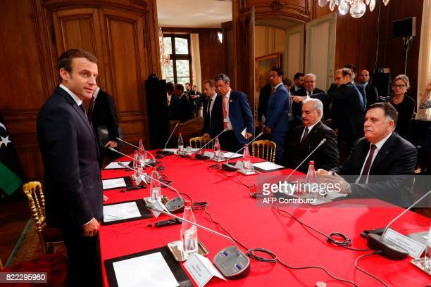 French President Emmanuel Macron with Libyan Prime Minister Fayez alSarraj and General Khalifa Haftar commander in the Libyan National Army take part...