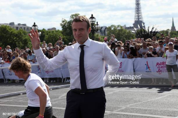 French president Emmnauel Macron play tennis during the Olympic Day Paris Olympic Park comes to life for Olympic Day on June 24 2017 in Paris France