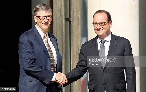 French President Francois Hollande accompanies Bill Gates cofounder of Microsoft and cofounder of the Bill and Melinda Gates Foundation after their...