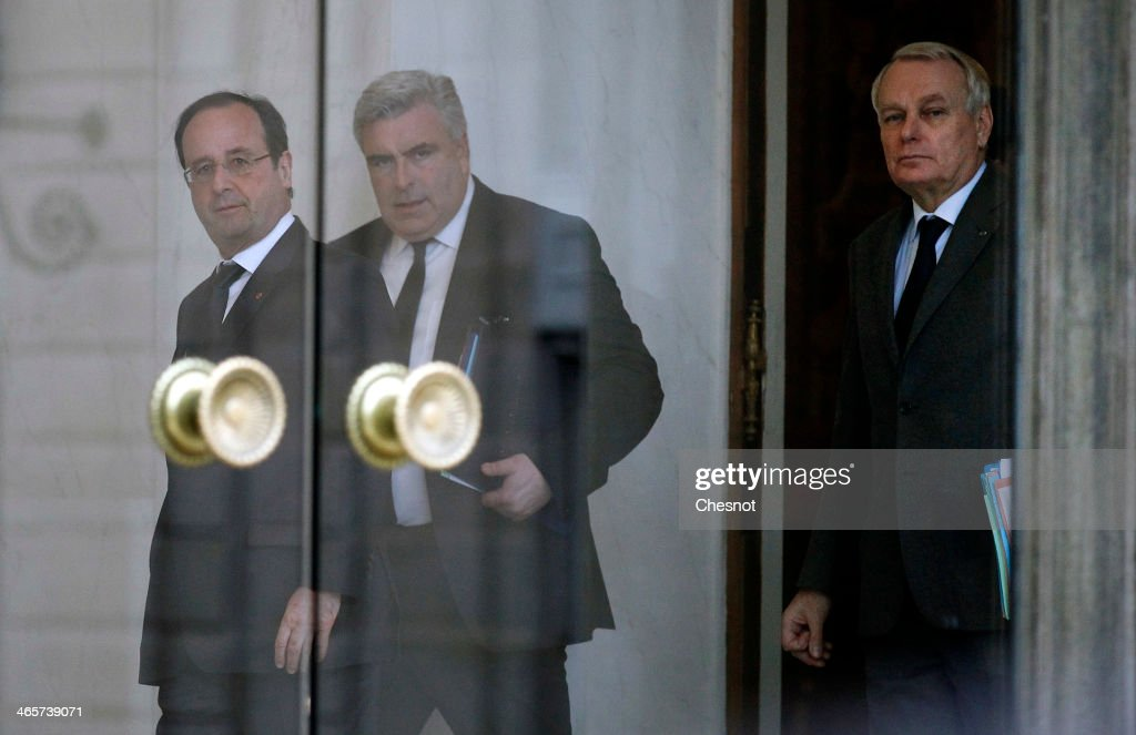 French President Francois Hollande (L) accompanies Junior Minister for Transports and Maritime Economy, Frederic Cuvillier and Prime Minister, <a gi-track='captionPersonalityLinkClicked' href=/galleries/search?phrase=Jean-Marc+Ayrault&family=editorial&specificpeople=551961 ng-click='$event.stopPropagation()'>Jean-Marc Ayrault</a> (R) after a weekly cabinet meeting at the Elysee presidential palace on January 3, 2014 in Paris, France.