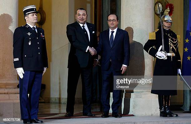 French President Francois Hollande accompanies King Mohammed VI of Morocco after their meeting at the Elysee on February 09 2015 at the Elysee Palace...