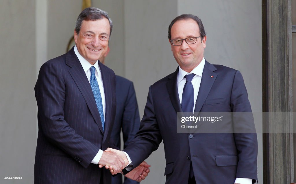 French President Francois Hollande (R) accompanies President of the European Central Bank (ECB) <a gi-track='captionPersonalityLinkClicked' href=/galleries/search?phrase=Mario+Draghi&family=editorial&specificpeople=571678 ng-click='$event.stopPropagation()'>Mario Draghi</a>, after their meeting at the Elysee palace on September 01, 2014 in Paris, France. Reportedly in August 2014, Draghi called for a discussion on new fiscal policies to support European financial growth due to Europeans anxiety about deflation and that a possible euro crisis may be coming back.