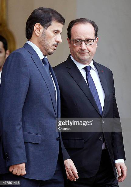 French President Francois Hollande accompanies Qatari Prime Minister Abdullah bin Nasser bin Khalifa Al Thani after their meeting at the Elysee...