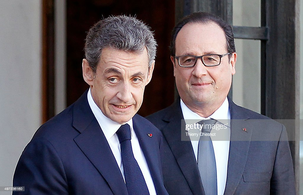 French President Francois Hollande (R) accompanies right-wing Les Republicains (R) party's President and former French President <a gi-track='captionPersonalityLinkClicked' href=/galleries/search?phrase=Nicolas+Sarkozy&family=editorial&specificpeople=211375 ng-click='$event.stopPropagation()'>Nicolas Sarkozy</a> after their meeting at the Presidential Elysee Palace on November 15, 2015 in Paris, France. Francois Hollande meets party leaders today after a series of fatal shootings in Paris on Friday.