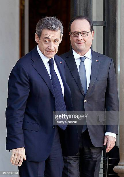 French President Francois Hollande accompanies rightwing Les Republicains party's President and former French president Nicolas Sarkozy after their...