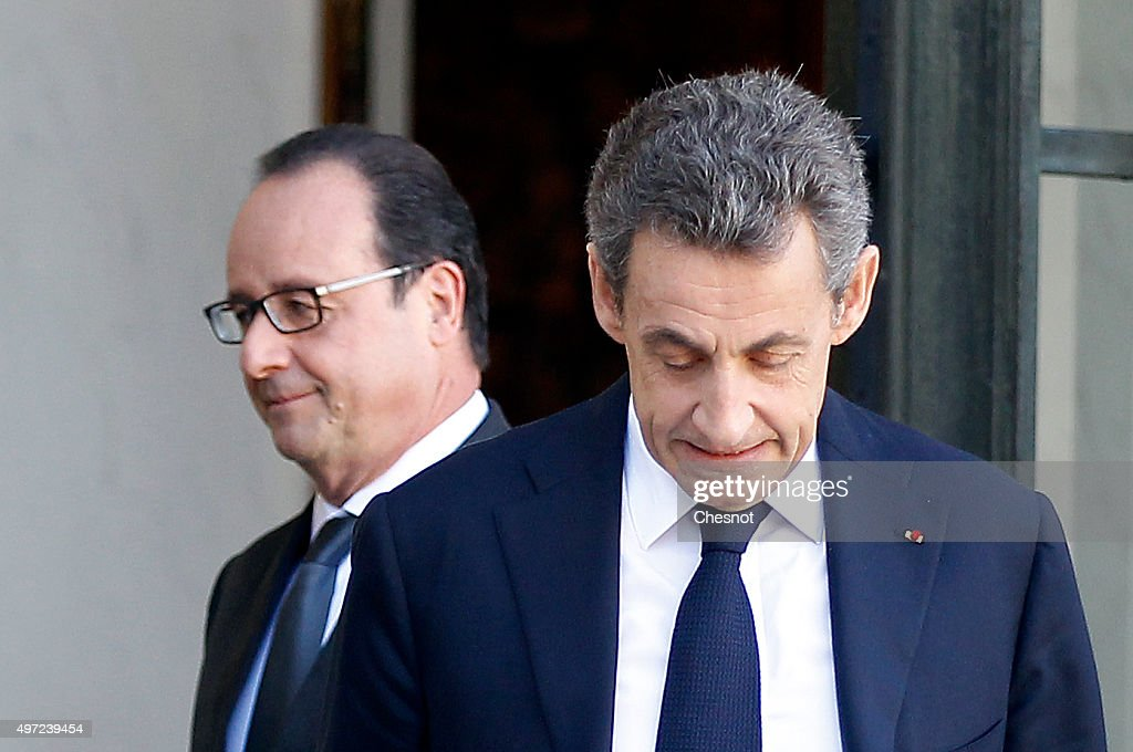 French President Francois Hollande accompanies rightwing 'Les Republicains' party's President and former French President Nicolas Sarkozy at the...