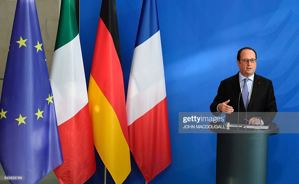 French President Francois Hollande addresses a joint press conference with the german chancellor and Italy's Prime Minister ahead of talks following the Brexit referendum at the chancellery in Berlin, on June 27, 2016. Britain's shock decision to leave the EU forces German Chancellor Angela Merkel into the spotlight to save the bloc, but true to her reputation for prudence, she said she would act neither hastily nor nastily. / AFP / John MACDOUGALL